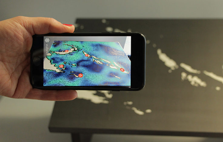 Layering of real-time climate data onto a printed map via augmented reality. © SPK / S. Faulstich